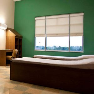 WebbLok Suicide Resistant Solar Screen Shade in a patient bedroom