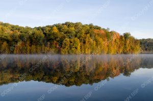 lake with fall color trees in background