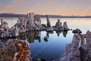 body of water with rocks and mountains