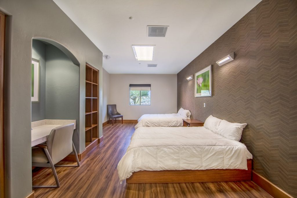 behavioral health facility bedroom with two queen beds